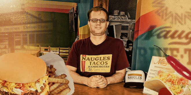 Christian Ziebarth is wearing a Naugles Taco Hamburgers shirt and flanked by a hamburger and a taco.