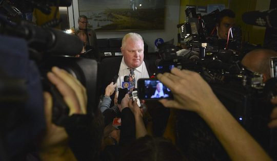 Mayor Rob Ford surrounded by cameras looming around him as he makes an announcement.