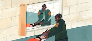 A corrections officer looks at himself in the mirror.