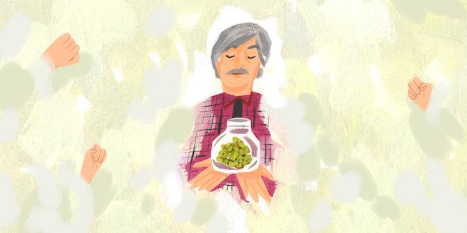 A man bring a jar of medical marijuana from on high.